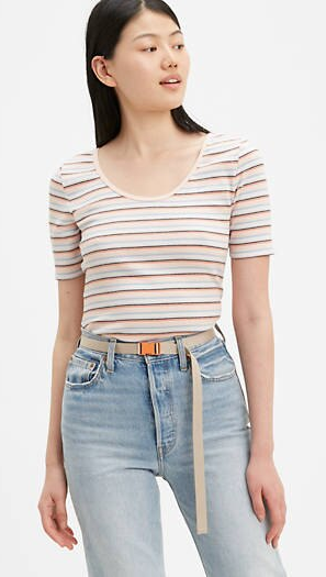 asian model wearing Levi's Venie Tee in Ariadne Stripe Peach Blush Multi-Color with Levi's jeans